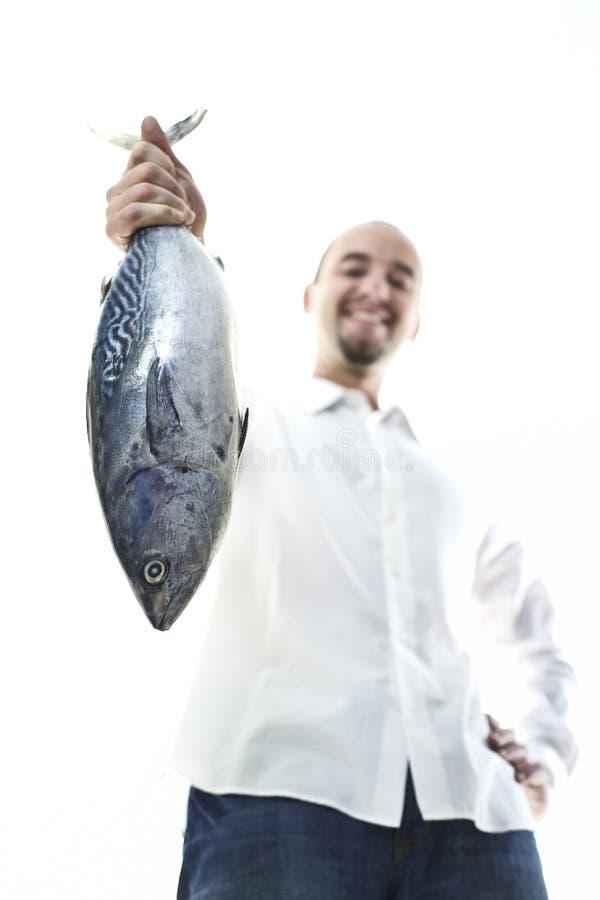 Homem com peixes imagem de stock royalty free