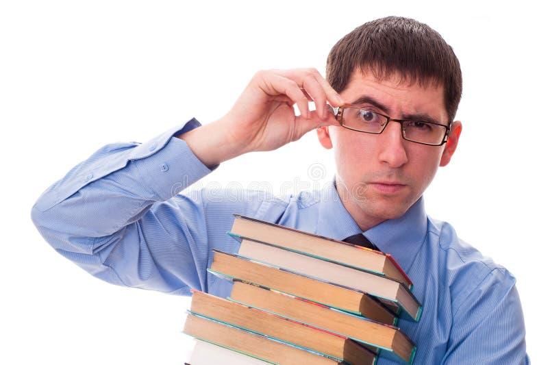Homem com a pilha de livros fotografia de stock royalty free