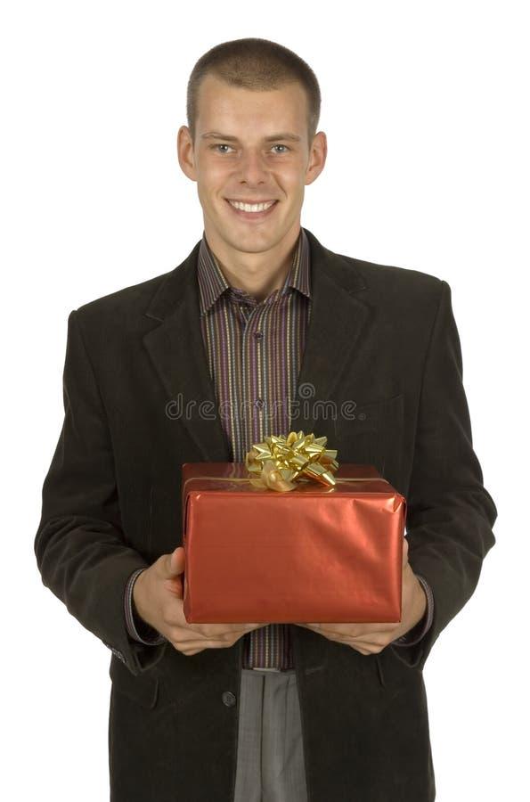 Homem com presente fotos de stock