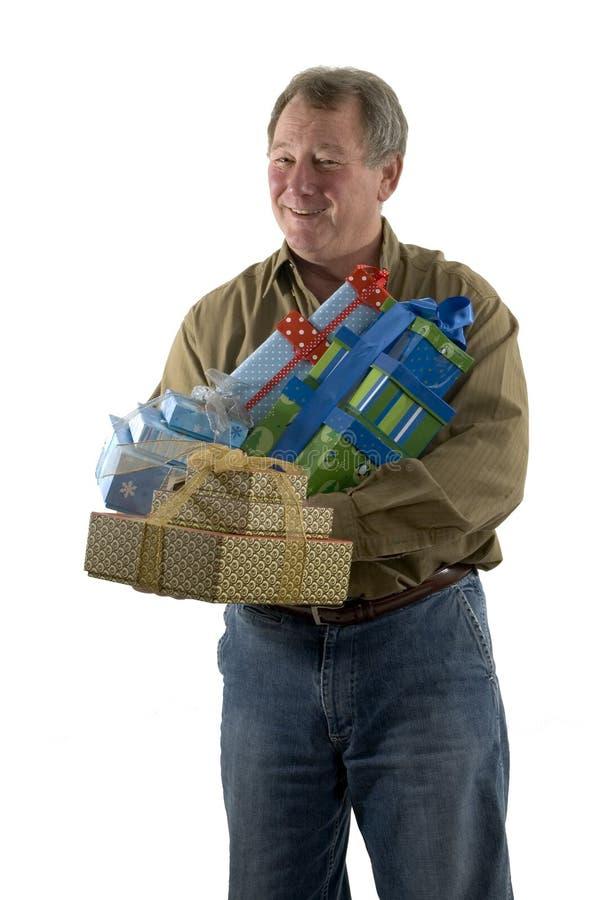 Homem com presentes fotos de stock royalty free