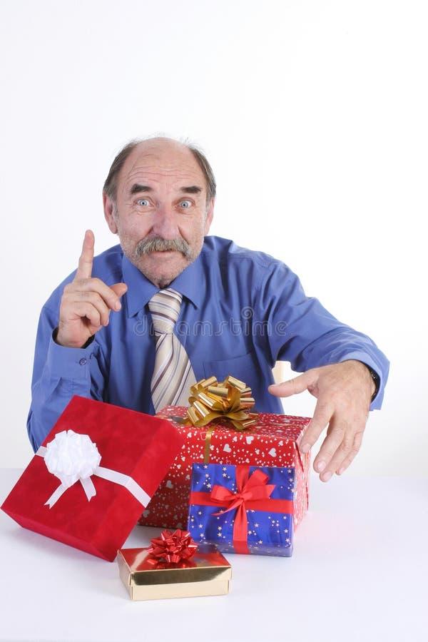 Homem com presentes fotografia de stock