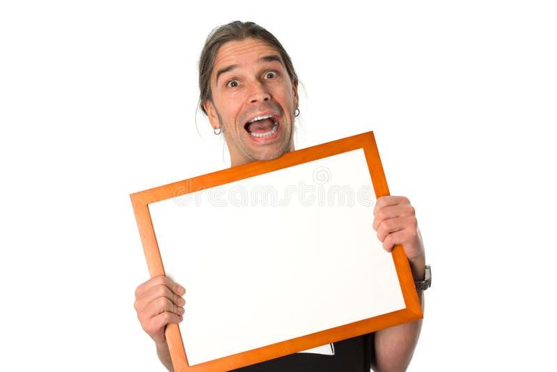 Homem com quadro indicador branco foto de stock