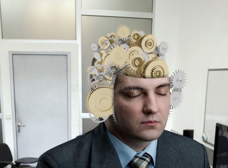 Homem com rolamento em seu cérebro foto de stock royalty free