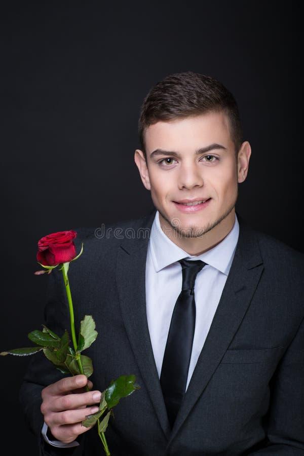 Homem com Rosa vermelha fotos de stock