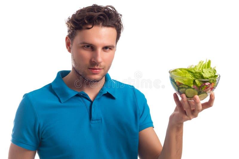 Homem com a salada isolada no fundo branco imagens de stock royalty free