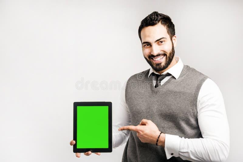 Homem com a tabuleta no branco fotos de stock royalty free