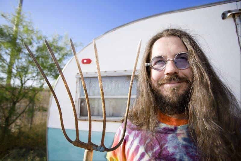 Homem com um Pitchfork fotos de stock