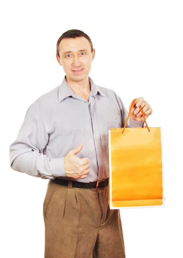 Homem com um saco para comprar imagem de stock
