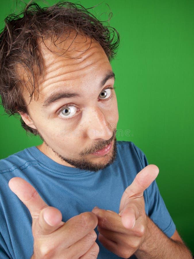 Homem com uma barba que aponta em você fotografia de stock
