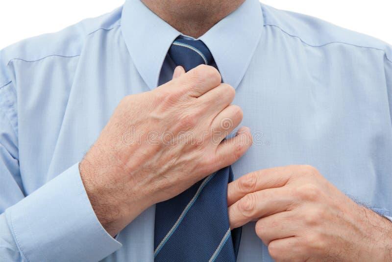 Homem com uma gravata no branco fotos de stock