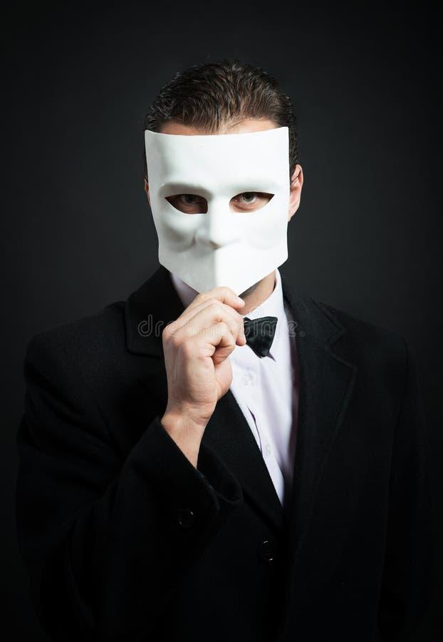 Homem com uma máscara fotos de stock royalty free
