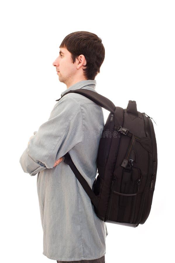Homem com uma mochila imagens de stock
