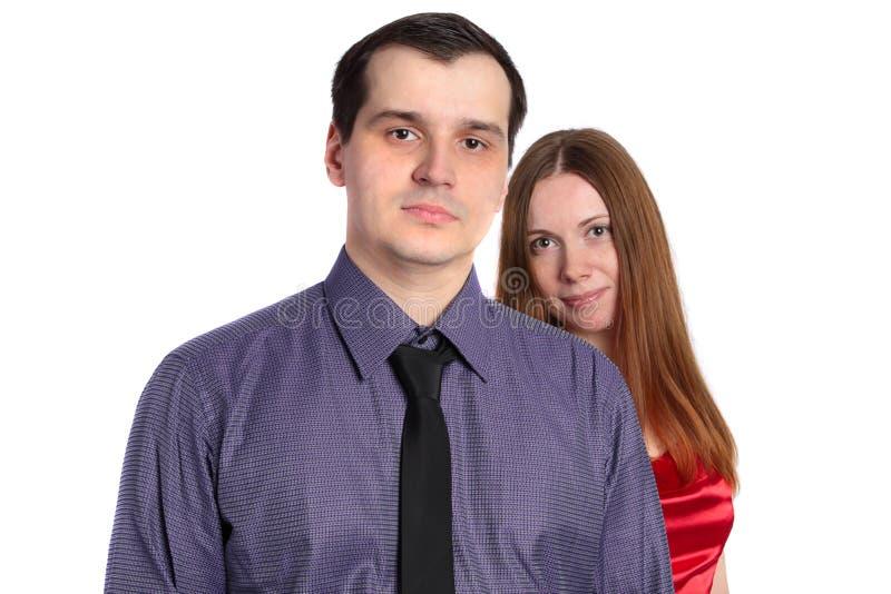 Homem confiável e uma mulher atrás dele fotos de stock