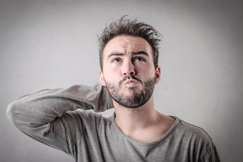 Homem confuso fotografia de stock