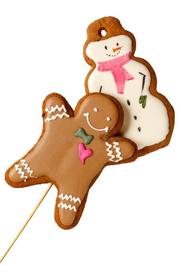 Homem congelado tradicional das cookies do Natal do pão-de-espécie com os bonecos de neve isolados fotos de stock