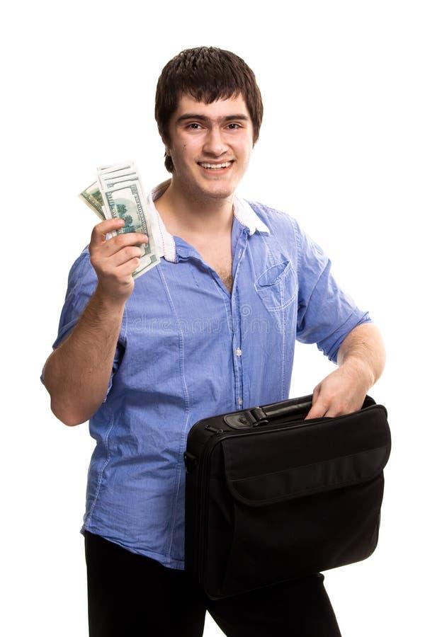 Homem considerável com dólares da terra arrendada do caso fotografia de stock royalty free
