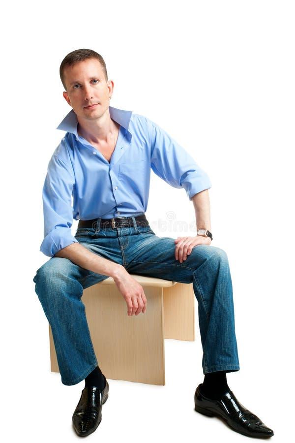 Homem considerável de assento foto de stock royalty free