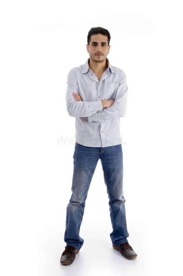 Homem considerável ereto com braços cruzados fotos de stock