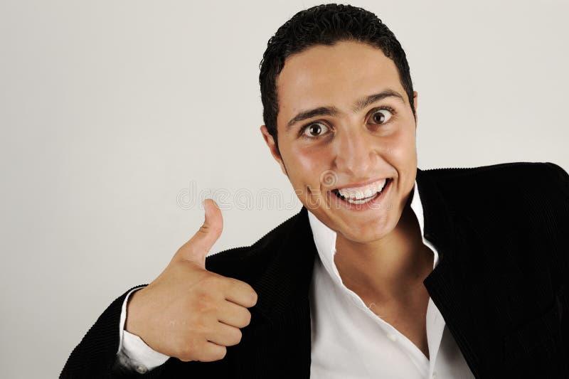 Homem considerável feliz com manuseio imagem de stock royalty free