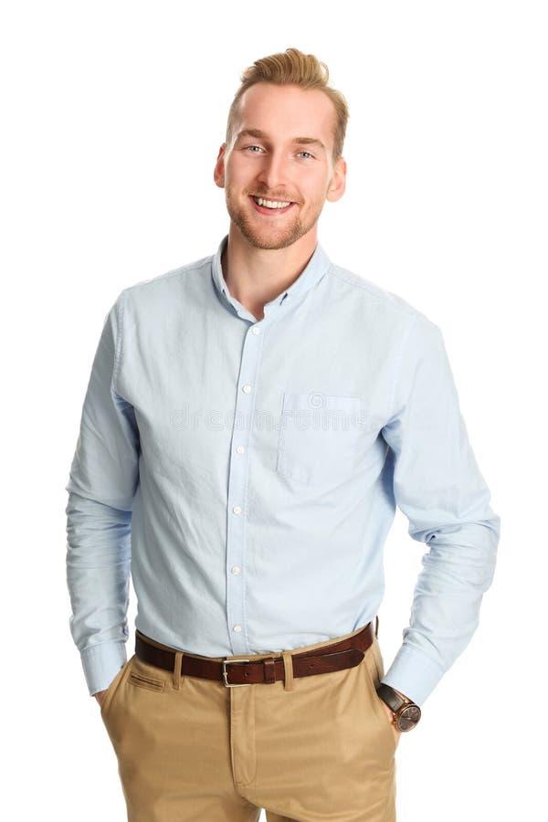 Homem considerável no sorriso azul da camisa fotos de stock royalty free
