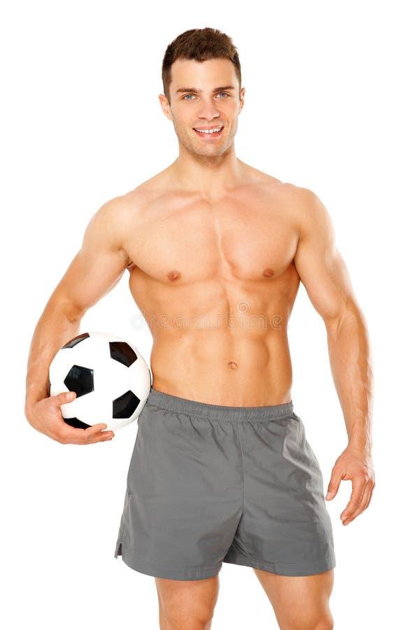 Homem considerável que guardara a bola de futebol no branco fotografia de stock royalty free