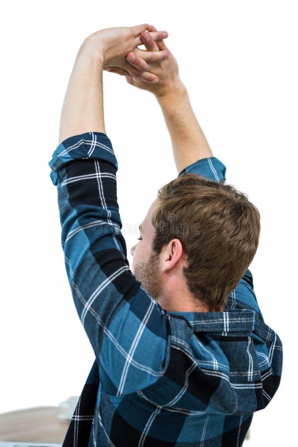 Homem considerável que outstretching seus braços fotografia de stock royalty free