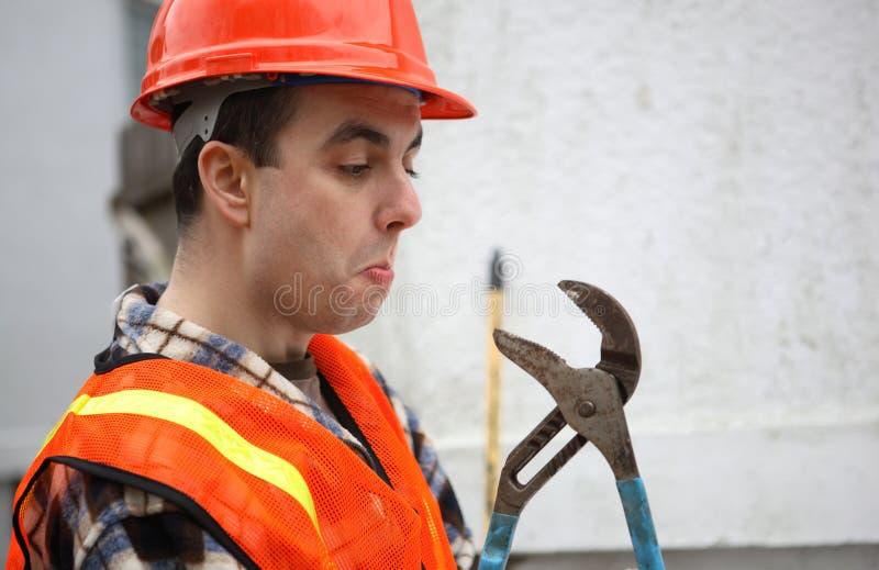 Homem contra a ferramenta imagens de stock