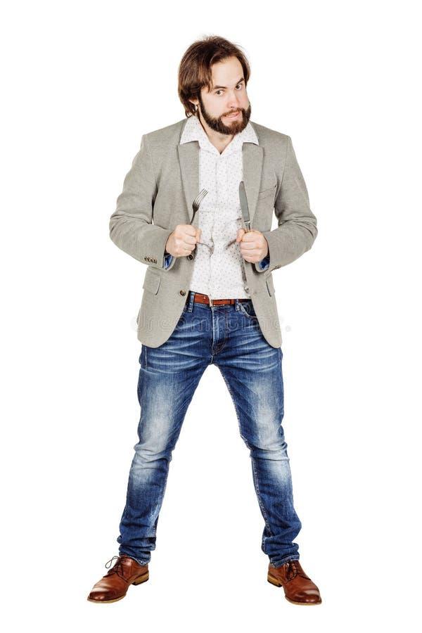 Homem da barba que guarda a forquilha e a faca da cutelaria disponível dieta, alimento, ele imagem de stock