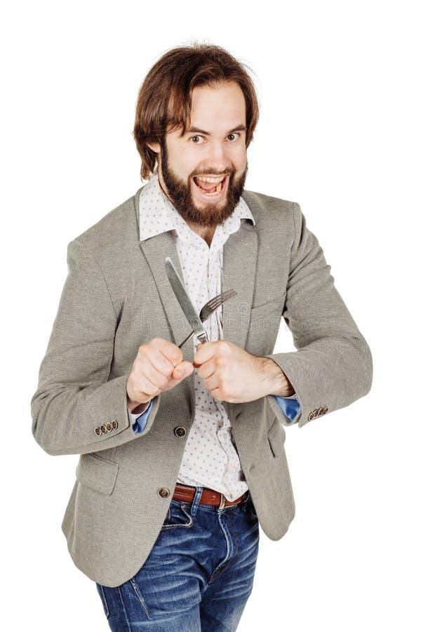 Homem da barba que guarda a forquilha e a faca da cutelaria disponível dieta, alimento, ele fotos de stock royalty free
