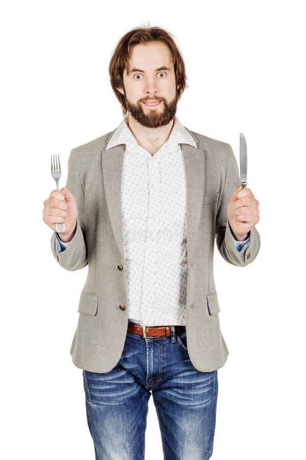 Homem da barba que guarda a forquilha e a faca da cutelaria disponível dieta, alimento, ele imagens de stock
