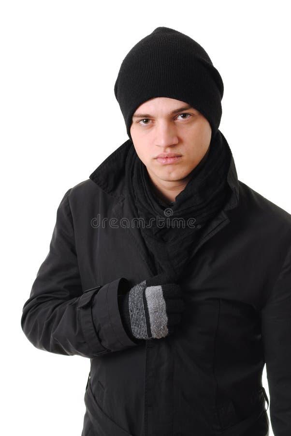 Homem de congelação com roupa do inverno fotografia de stock royalty free