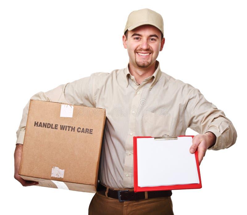 Homem de entrega de sorriso foto de stock