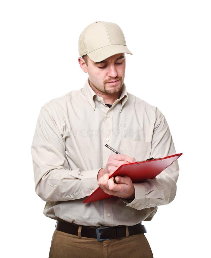 Homem de entrega no dever fotografia de stock
