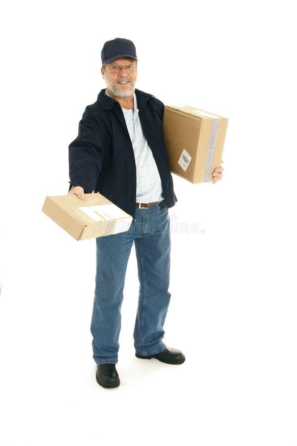 Homem de entrega no trabalho fotos de stock