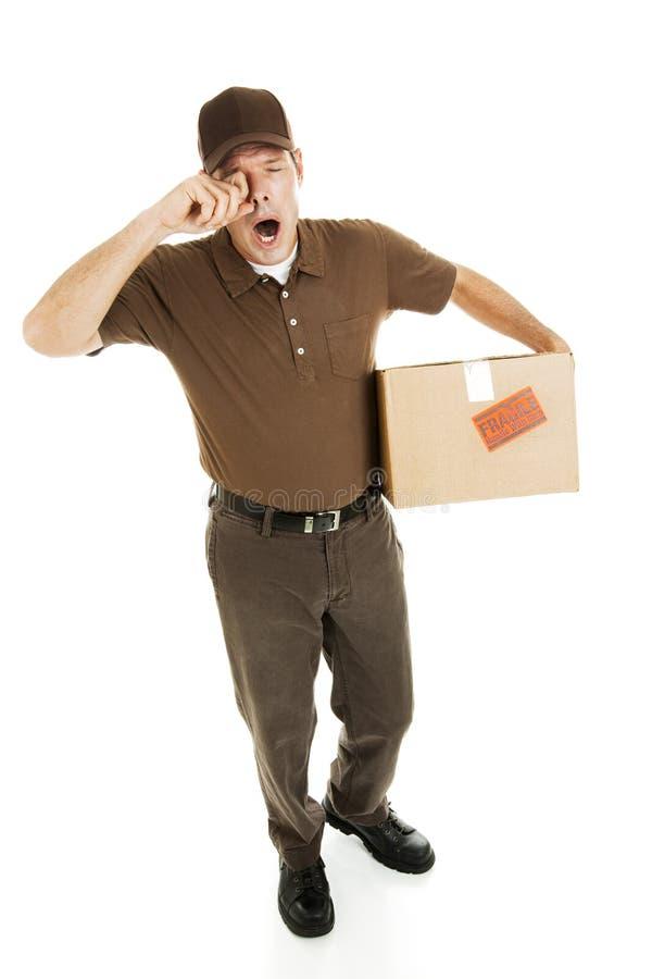 Homem de entrega Tired foto de stock