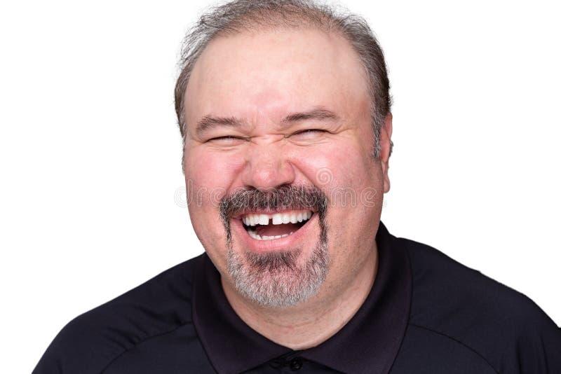 Homem de meia idade que aprecia um bom riso fotografia de stock royalty free