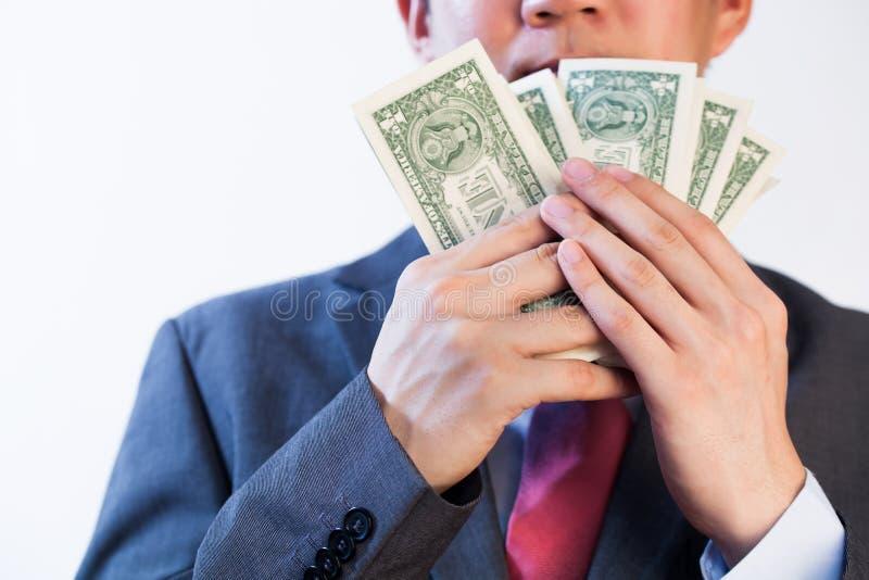 Homem de negócio ávido que mostra fora seu dinheiro foto de stock royalty free