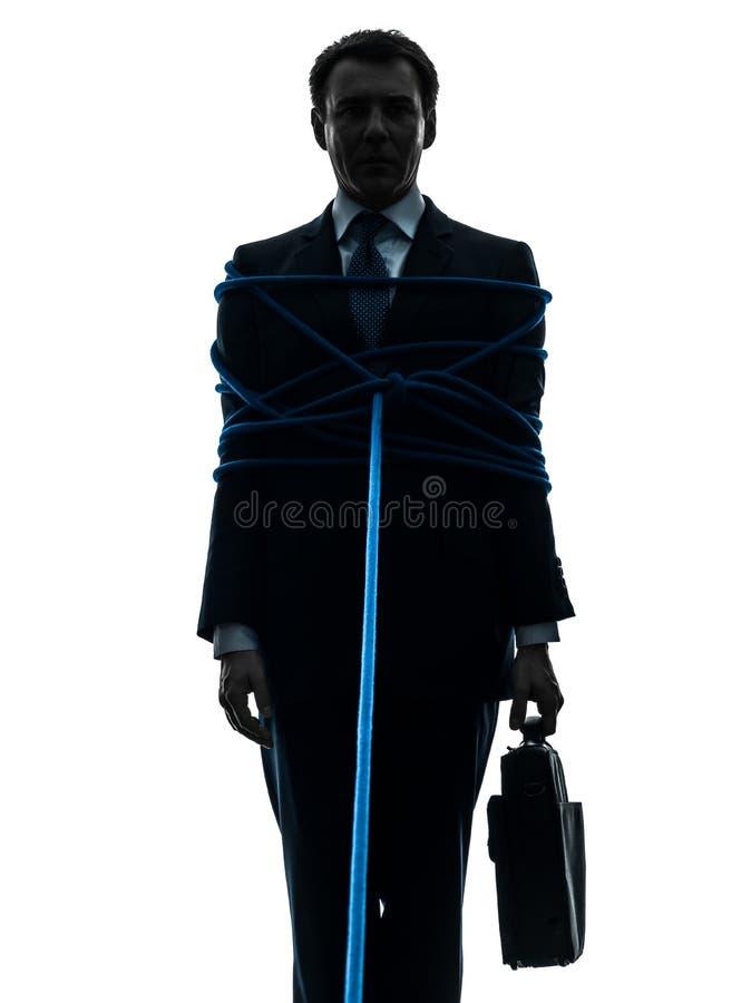 Homem de negócio amarrado acima da silhueta do prisioneiro fotos de stock royalty free