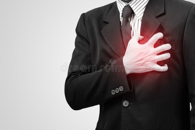 Homem de negócio asiático com sintomas do coração imagem de stock