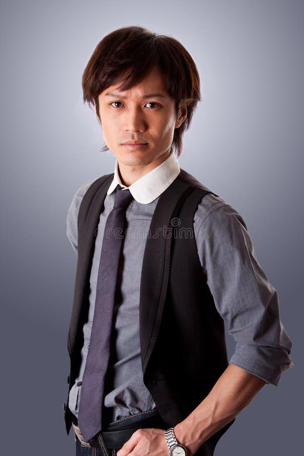 Homem de negócio asiático confiável fotos de stock