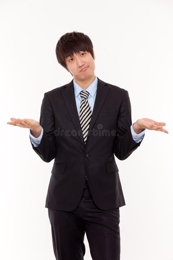 Homem de negócio asiático novo com problema fotos de stock royalty free