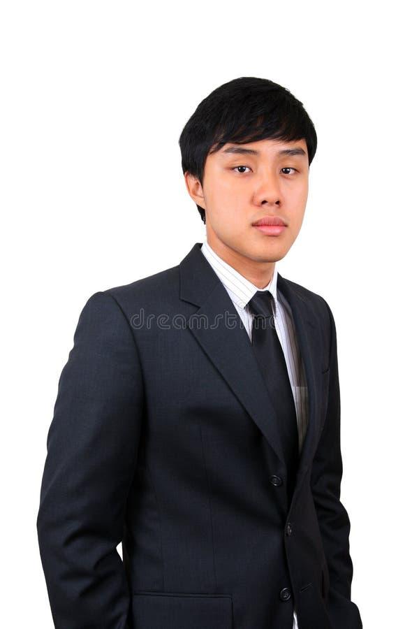 Homem de negócio asiático novo e confiável. foto de stock