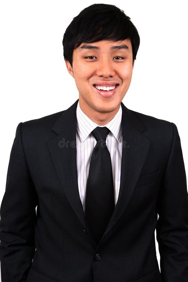 Homem de negócio asiático novo e confiável. fotos de stock