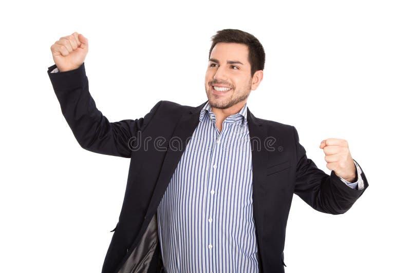 Homem de negócio bem sucedido isolado sobre cheering do branco e m feliz imagens de stock royalty free