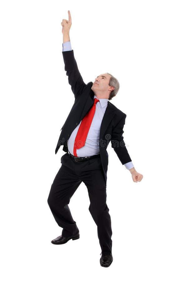 Homem de negócio bem sucedido que aponta seu dedo fotos de stock royalty free