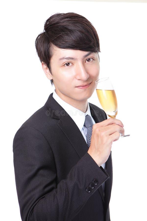 Homem de negócio bem sucedido que brinda com Champagne imagens de stock