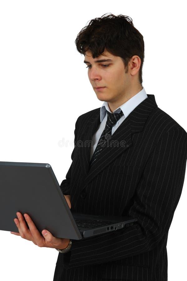 Homem de negócio bem sucedido que trabalha com portátil fotografia de stock royalty free
