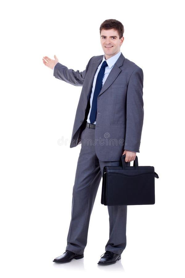 Homem de negócio com apresentação da pasta imagens de stock