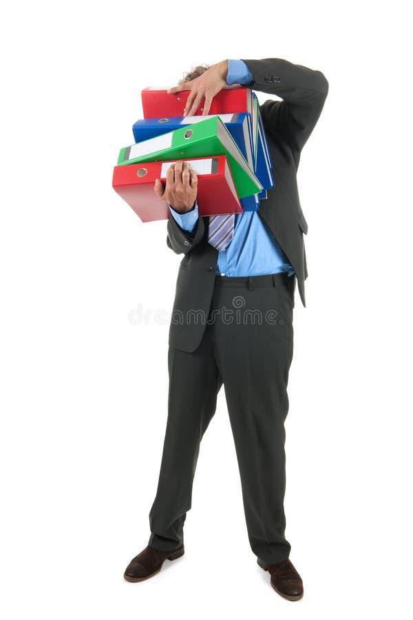 Homem de negócio com arquivo pesado fotos de stock