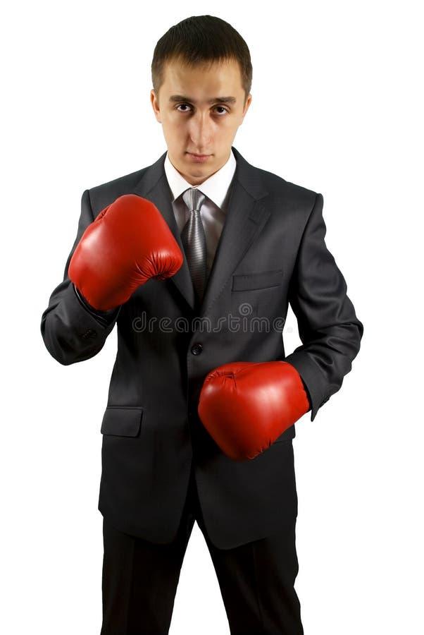 Homem de negócio com as luvas de encaixotamento do vermelho imagem de stock